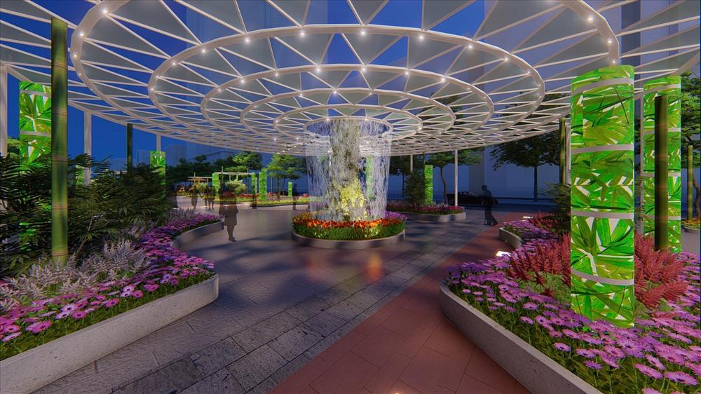 """Đại cảnh """"Rừng nước"""" lung linh và huyền ảo, đây là lần đầu tiên tại Đường hoa Nguyễn Huệ xuất hiện một cánh rừng cùng sự kết hợp với màn nước tạo nên hệ sinh thái thu nhỏ gợi nhớ đến các công trình sinh thái nổi tiếng trên thế giới như Cloud Forest trong Gardens by the Bay ở Singapore hay The Green Planet ở Dubai (UAE)."""
