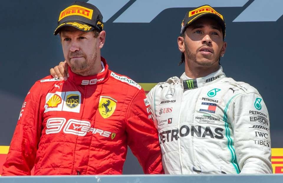 Vettel (trái) không hài lòng khi bị tước chiến thắng ở chặng trước.