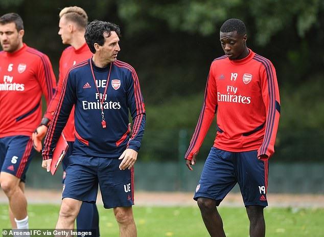 HLV Emery và cầu thủ Châu Phi đắt giá nhất lịch sử - Nicolas Pepe. Ảnh: Getty.