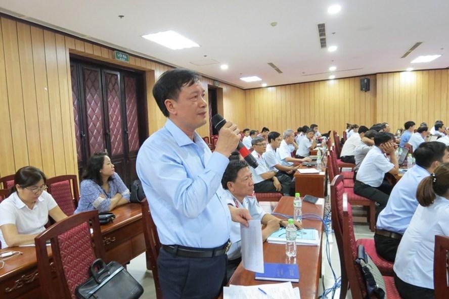 Giám đốc BHXH TPHCM Phan Văn Mến phát biểu ý kiến tại hội thảo. Ảnh: L.S