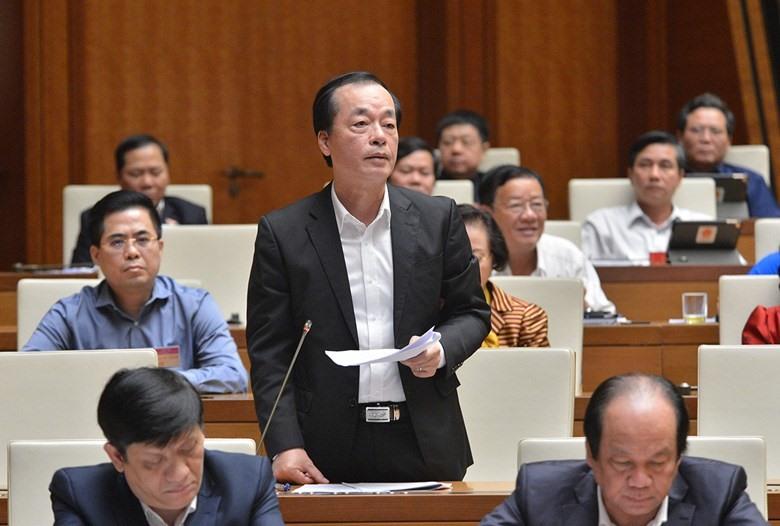 Bộ trưởng Bộ Xây dựng Phạm Hồng Hà trả lời chất vấn của các đại biểu Quốc hội.
