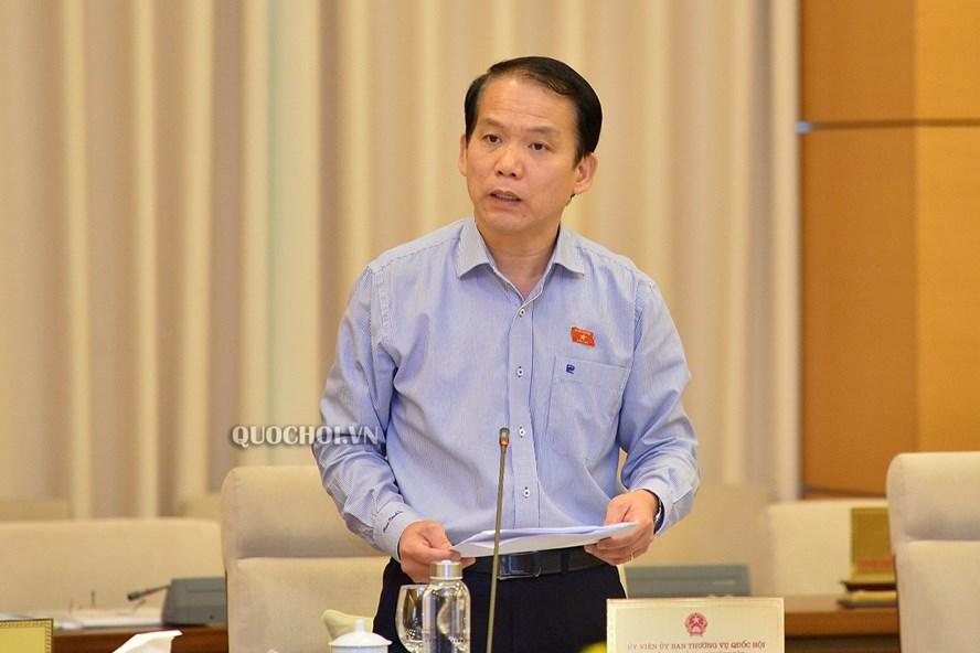 Chủ nhiệm Ủy ban Pháp luật Hoàng Thanh Tùng báo cáo một số nội dung. Ảnh Quochoi.vn