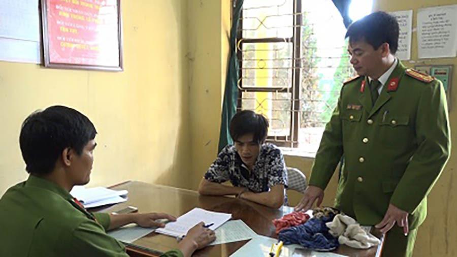 Phạm Ngọc Hậu tại cơ quan công an.