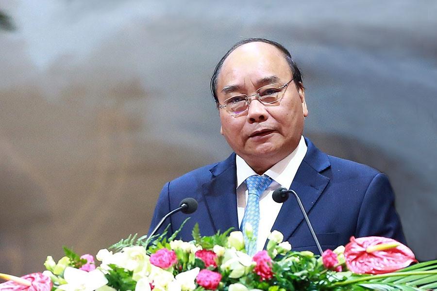Thủ tướng Chính phủ Nguyễn Xuân Phúc đối thoại với các đại biểu tại Đại hội XII Công đoàn Việt Nam. Ảnh: HẢI NGUYỄN