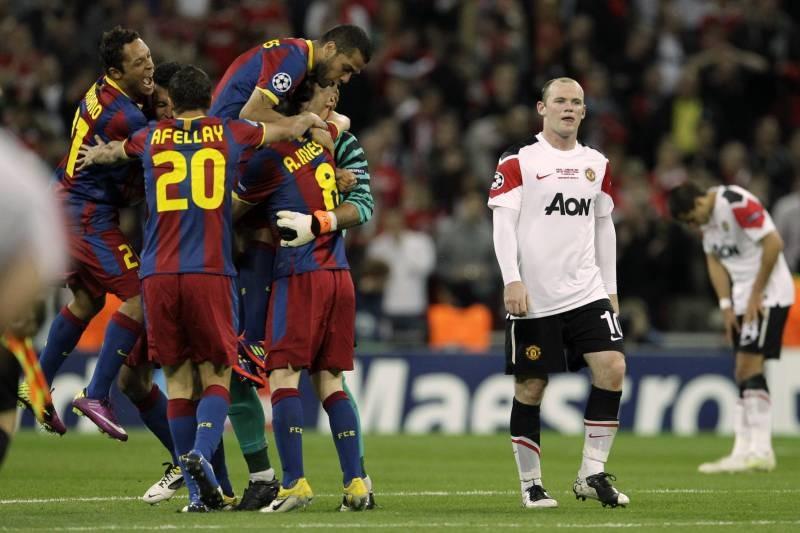 Lần thứ 2 Rooney và đồng đội gục ngã trong trận chung kết trước một Barca quá mạnh. Ảnh: Matt Dunham.