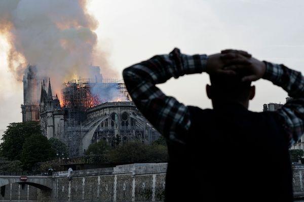 Nhà lãnh đạo Pháp cho biết sẽ khởi động chiến dịch gây quỹ để cùng xây dựng lại Nhà thờ Đức Bà Paris. Ảnh: Getty.