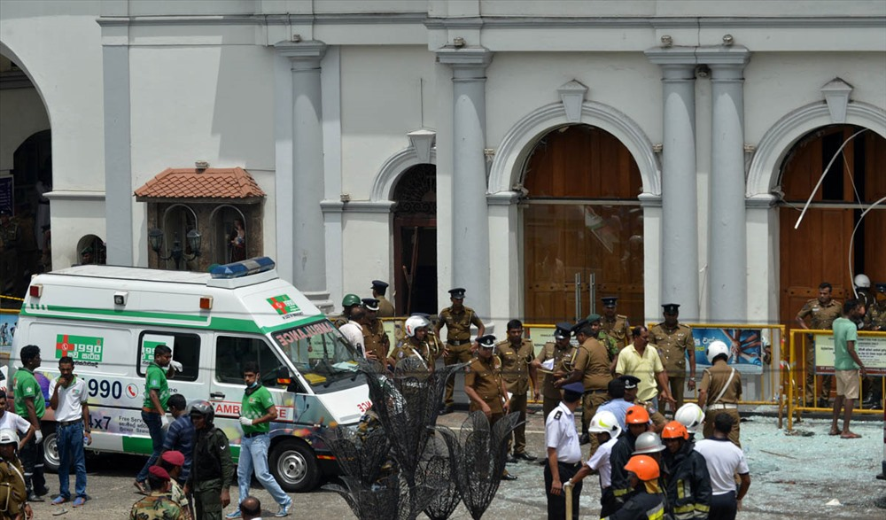 An ambulance is seen outside the church premises with gathered security personnel following a blast at the St. Anthony's Shrine in Kochchikade, Colombo. ISHARA S. KODIKARA/AFP