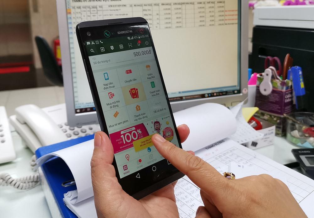 Trong hơn 20 triệu ví điện tử hiện nay, có hơn 4,2 triệu ví kết nối tài khoản ngân hàng (ảnh: PK).