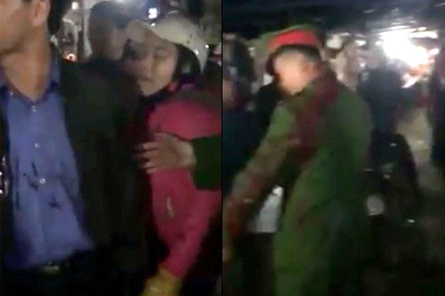 Ông Huấn và một số thành viên trong đoàn kiểm tra bị chị Loan hắt tiết lợn lên người. Ảnh cắt từ clip.