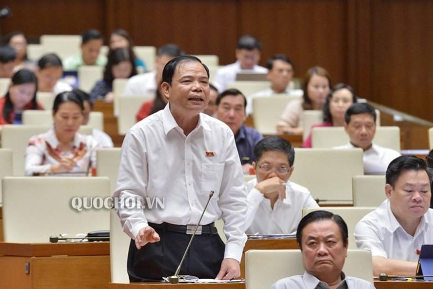 Bộ trưởng Bộ Nông nghiệp và Phát triển nông thôn Nguyễn Xuân Cường giải trình trước Quốc hội sáng 31.5. Ảnh: Quochoi.vn