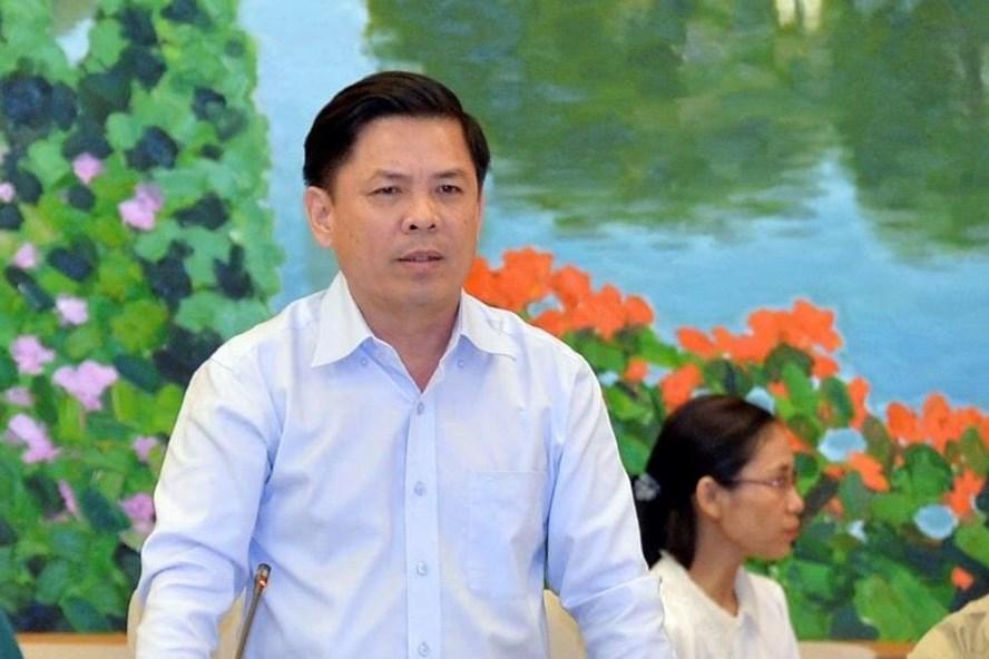 Bộ trưởng Bộ Giao thông Vận tải Nguyễn Văn Thể trả lời chất vấn. Ảnh PV